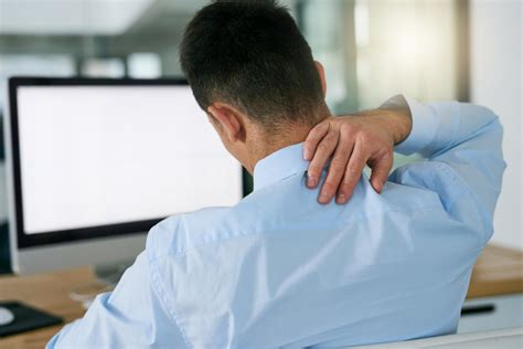 back pain from sitting at desk cervicalgia symptoms causes and treatment
