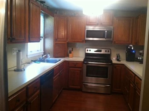 best way to refinish cabinets whats the best way to update oak kitchen cabinets