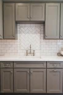 White Kitchen Backsplash Tile Gray Shaker Kitchen Cabinets With White Subway Tile Herringbone Sink Backsplash Transitional