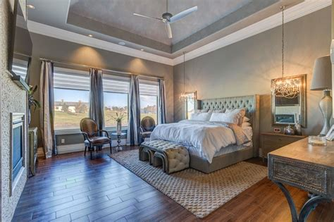 luxury bedroom lighting transitional master bedroom with high ceiling hardwood 12169   2b9591de1655a80683ba09a421fee952