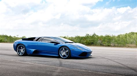 Blue Car On Runway Wallpaper - 9to5 Car Wallpapers