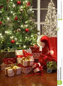 Brightly Lit Christmas Tree With Lots Of Gifts Stock Photo ...