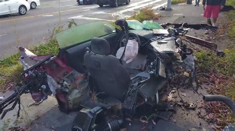 Ford Mustang Hits Light Pole Ripping The Car In 2, Driver