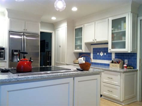 stainless kitchen cabinets shaker style cabinets with crown molding and gray granite 2467