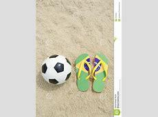 Soccer Ball Football And FlipFlops On Brazilian Beach