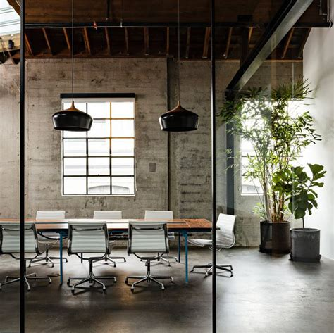 empty cubicles in a modern office building by the office trends of tomorrow designs to expect in 2016