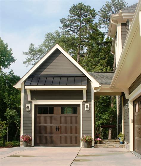 image of tile fireplace surround shed roof overhang with outdoor wall sconces garage