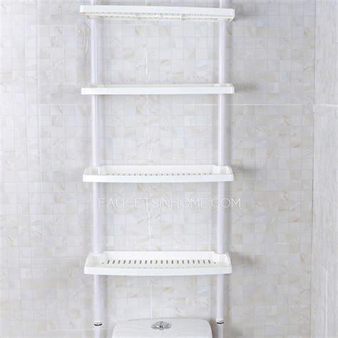 white plastic assemblable bathroom shelves over toilet