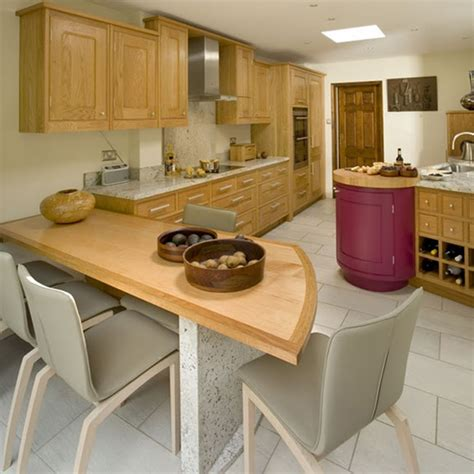 pale solid wood fitted kitchen cupboard units ceramic