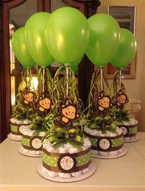 baby shower centerpieces with balloons monkey baby shower diapers centerpiece with balloon green brown diaper cake diaper cakes