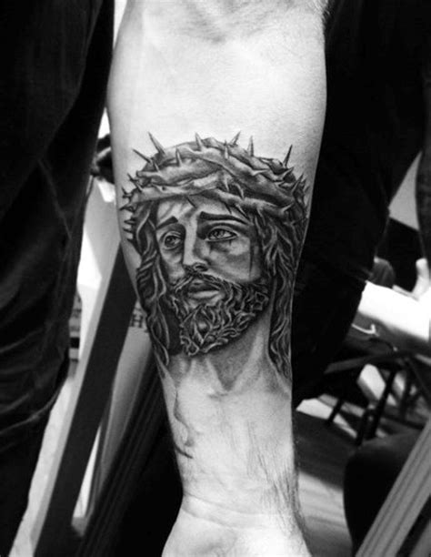 Religious Jesus Christ portrait in crown of thorns tattoo on forearm - Tattooimages.biz