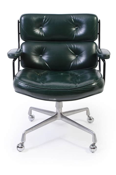 time chair by eames for herman miller in green