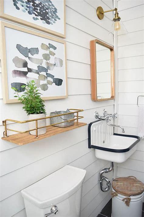 modern farmhouse basement bathroom  white shiplap walls dark tile floors chrome wall