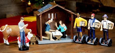 modern nativity scene depicts baby jesus  selfies