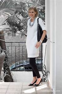 Wearing a white dress with black leggings