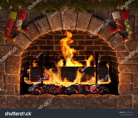 fireplace burning yule log in hearth decorated