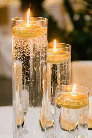 gold and cream pillar candles black and white winter wedding in chicago decorations wedding 50th wedding anniversary
