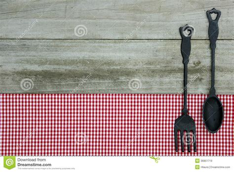 cast iron spoon  fork  red gingham tablecloth