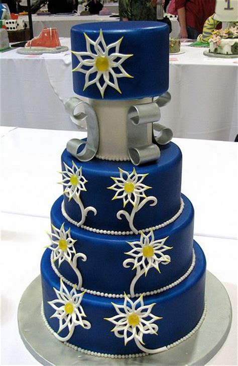 tier  dark blue wedding cake  white flower