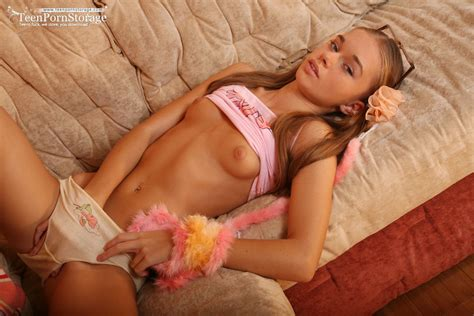cute teenie In High Socks stripping And Posing On A Couch and Showing Off her Pink pussy