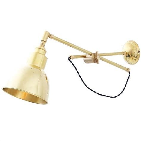 large solid brass swing arm adjustable wall light with briaded cable
