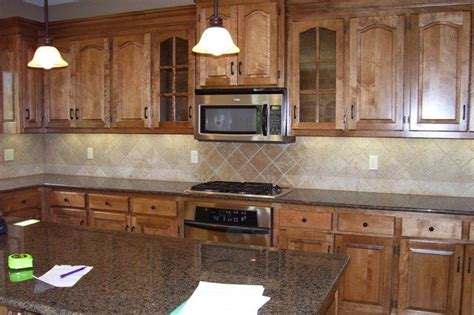 what color cabinets go with baltic brown granite anyone