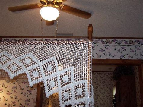 Canopy Bed W/ Lilac Decorations And Ceiling Fan