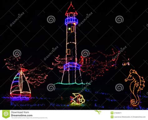 christmas lights tropical lighthouse theme stock image