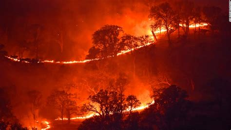 Flames from a backfire move away from a barn threatened by. Three major raging wildfires largely contained in California