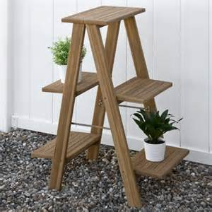 four tiered ladder style teak plant stand outdoor