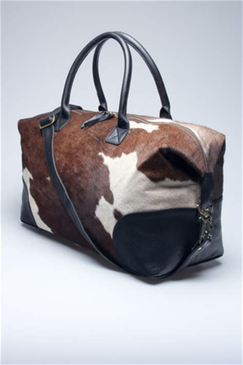 cowhide duffle bag by found object fancy - Cowhide Overnight Bag