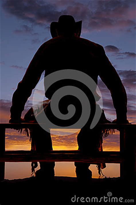 silhouette cowboy sit fence royalty  stock photography