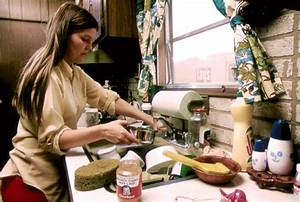 File:HOUSEWIFE IN THE KITCHEN OF HER MOBILE HOME IN ONE OF ...