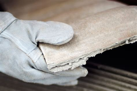 remove asbestos shingles   wood house