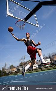 Photo Of Man Playing Basketball