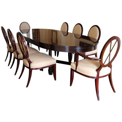 dining table with x back dining chairs by barbara barry