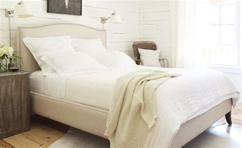 Soft Cream And White Bed Linens Create A Cozy, Airy