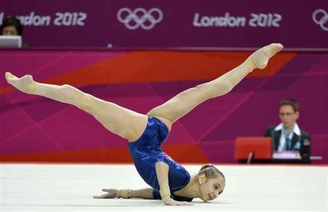 russian gymnast victoria komova goes through her routine