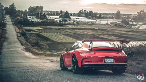 awesome red porsche  gt rs rear side angle sssupersports