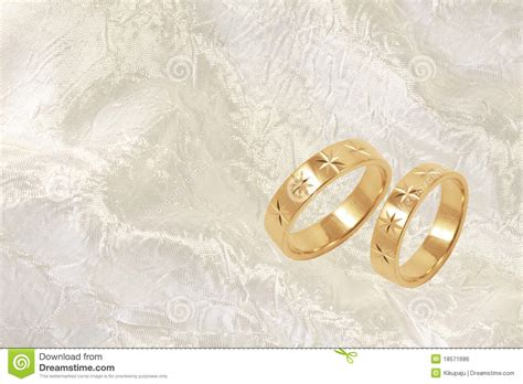 gold wedding rings on white festive background royalty
