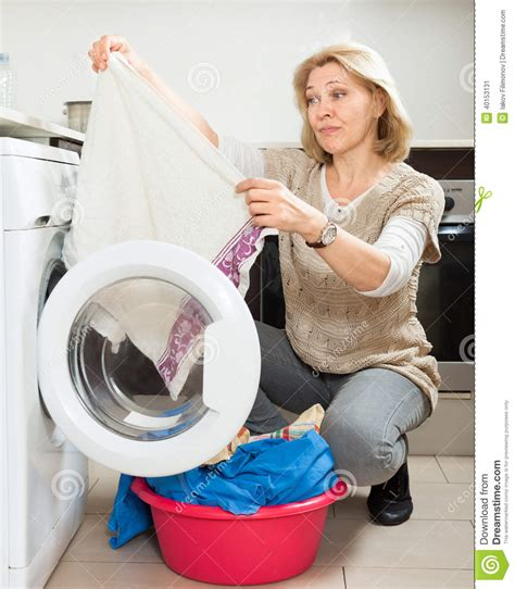 doing laundry by tired woman doing laundry with washing machine stock photo image 40153131