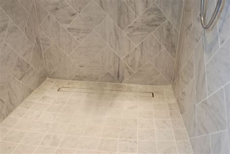 beautiful custom designed porcelain tile shower featuring