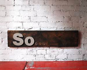 hand made sign with metal letters on old wood so sign With wood sign with metal letters