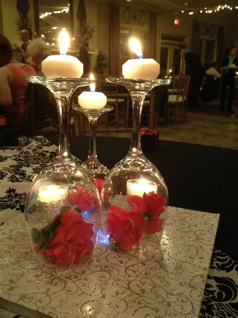 the bride made these centerpieces herself with wine