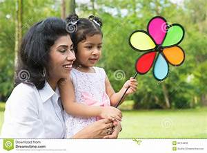 Parent And Child Playing Windmill Stock Photo - Image of ...
