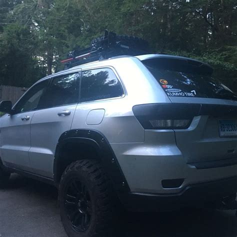 jeep laredo blacked out lifted wk2 jeep grand cherokee kumho tires blacked out