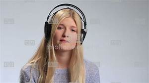 Sad Girl With Headphones Listening To Music Stock video ...