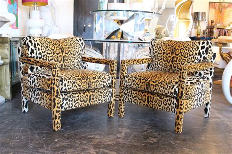 pair of leopard parson chairs in the style of milo