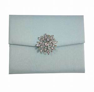 padded light blue silk envelope with star brooch With silk envelope wedding invitations