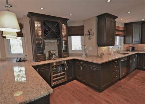 stunning dark stain cabinets  stone countertops mylen